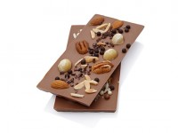 Milk chocolate bar crowned with a selection of premium nuts, cocoa nibs and crunchy chocolate balls
